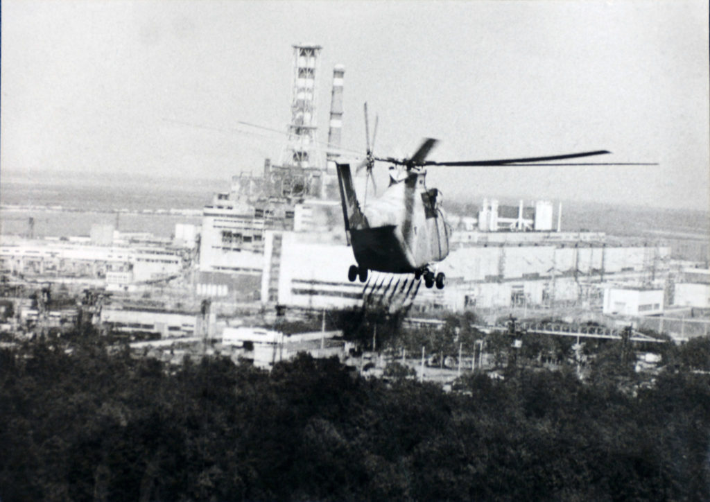 A helicopter moves in to help experts check the damage to the Chernobyl nuclear power plant reactor in April 1986