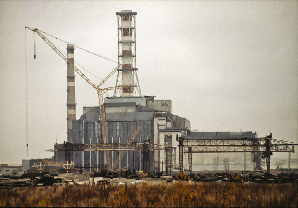 Reactor number 4 of the Chernobyl nuclear power station, cause of the catastrophic nuclear accident of April 26, 1986, in its concrete sarcophagus containment structure in the wooded, marshy area near the Ukraine-Belarus border in 1990