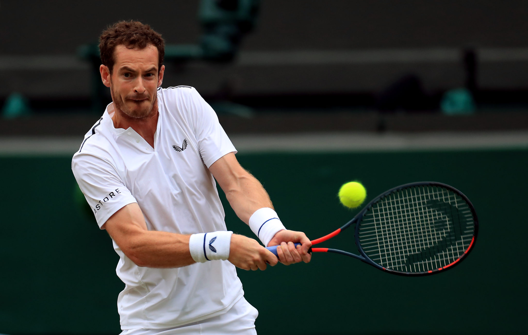 Andy Murray strikes a ball during a match.