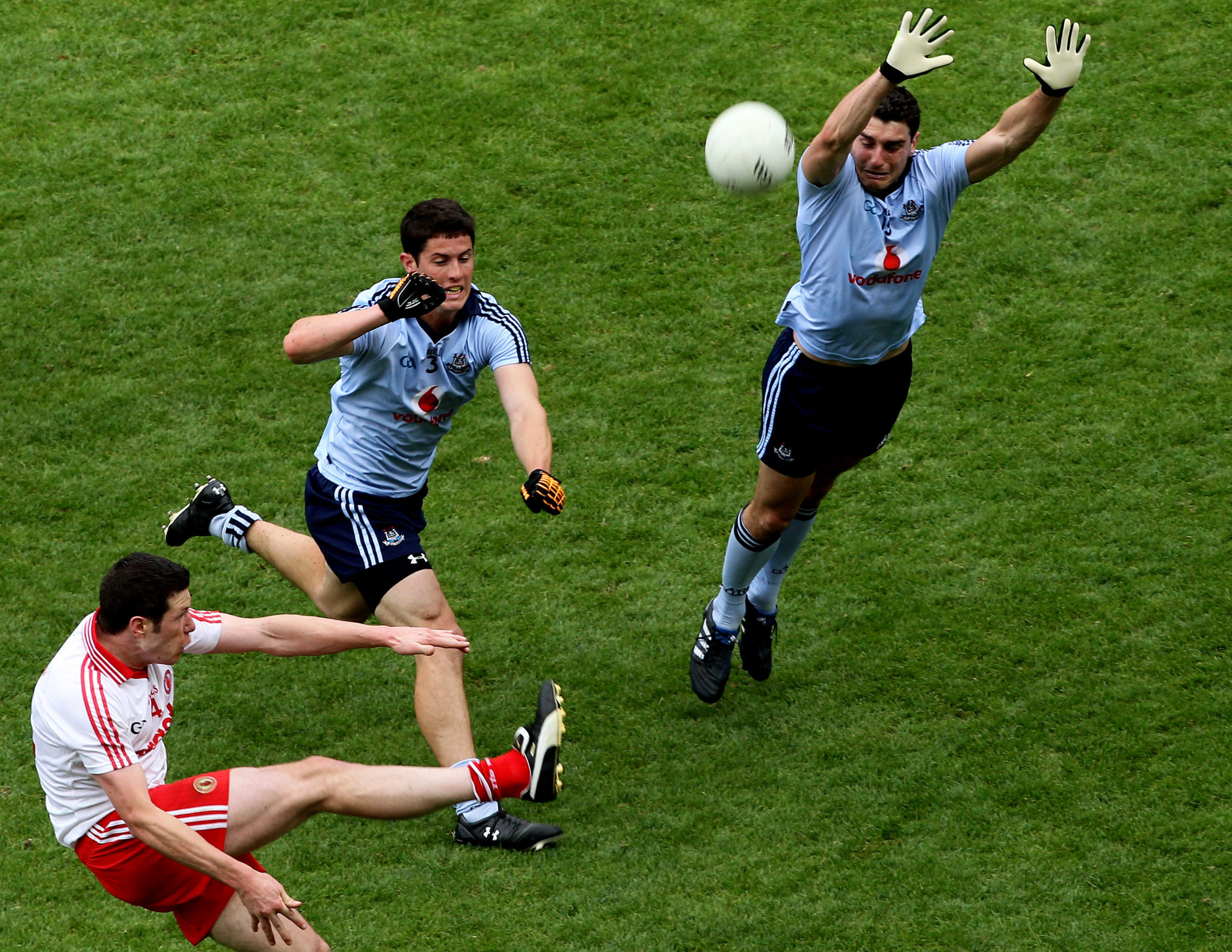 Bernard Brogan attempts to block a ball in a GAA match against Tyrone