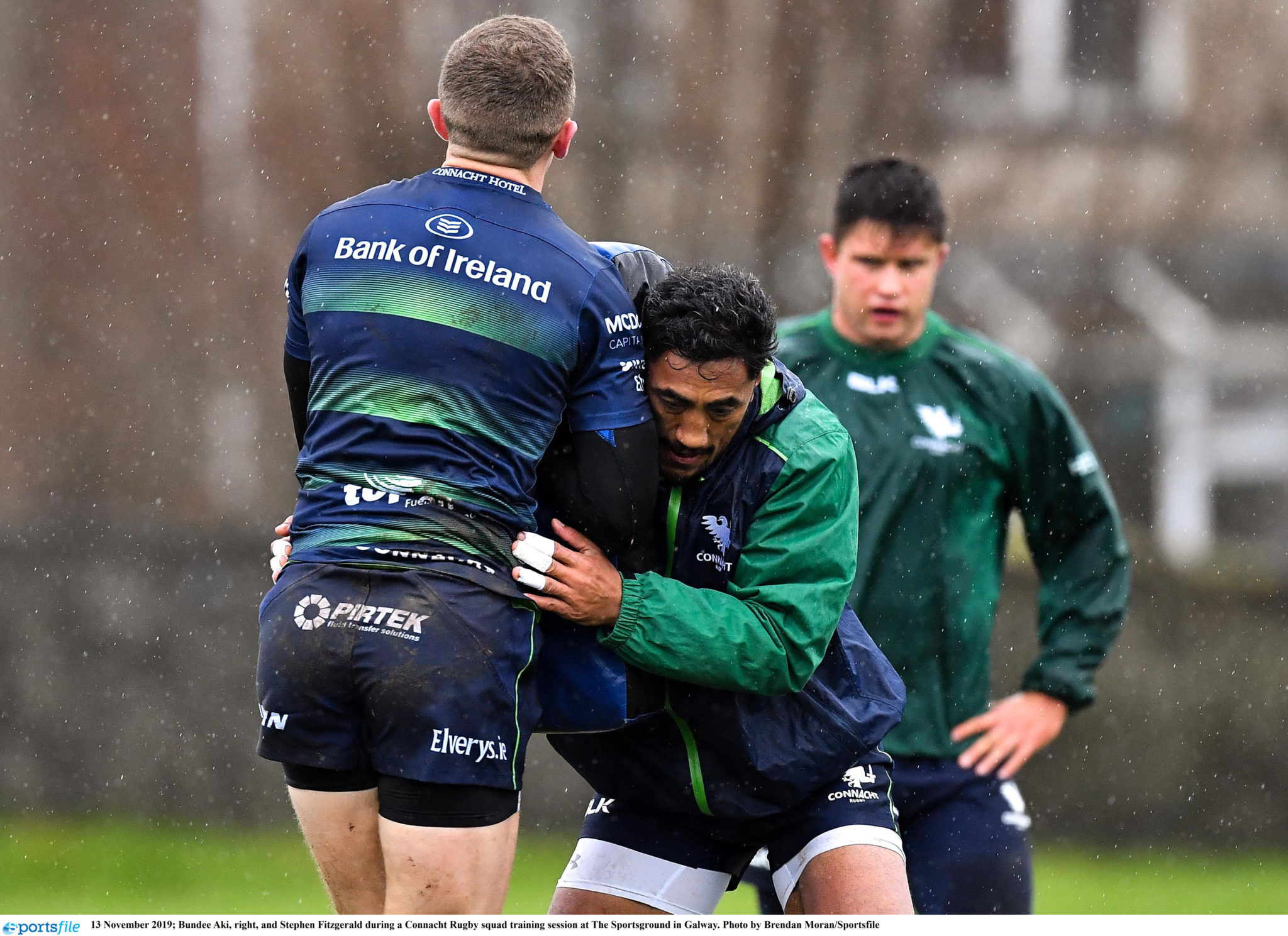 Bundee Aki and Shane Fitzgerald work during a Connacht training session in 2019.
