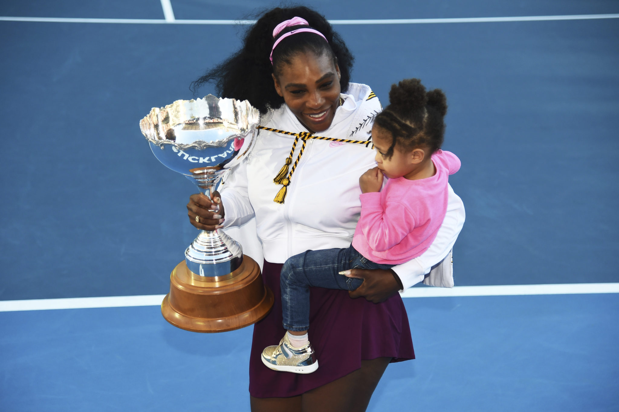 Serena Williams stands with her daughter after winning at the ASB Classic in Auckland
