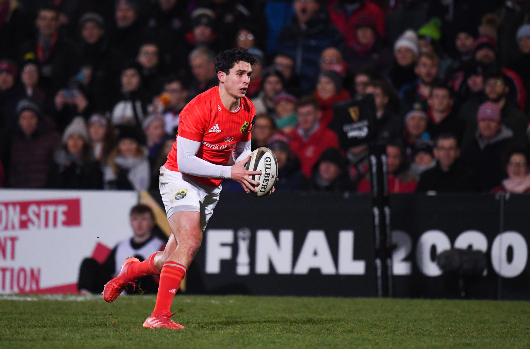 Joey Carbery carries the ball forward for Munster.