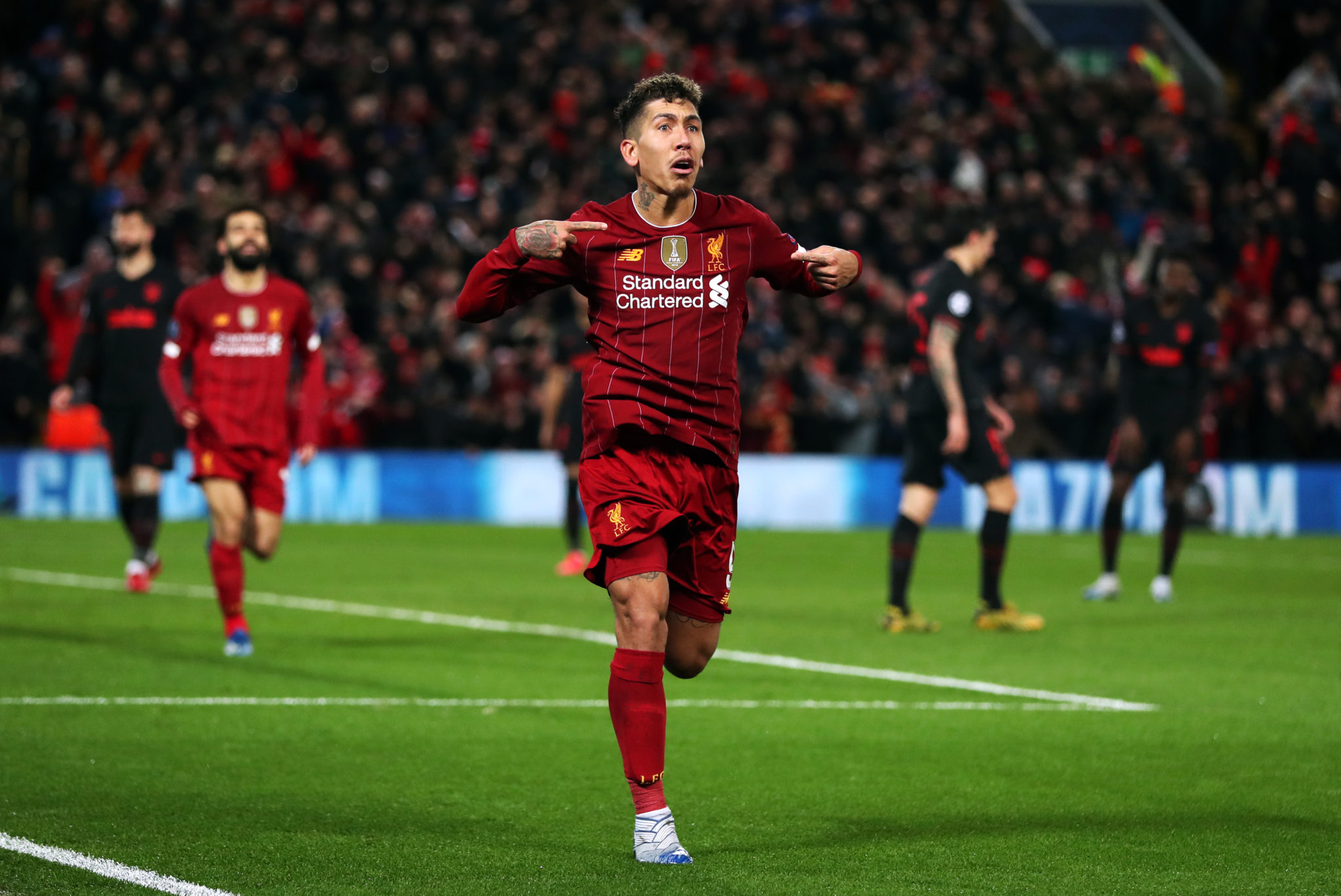 Roberto Firmino of Liverpool celebrates a goal in the Champions League.