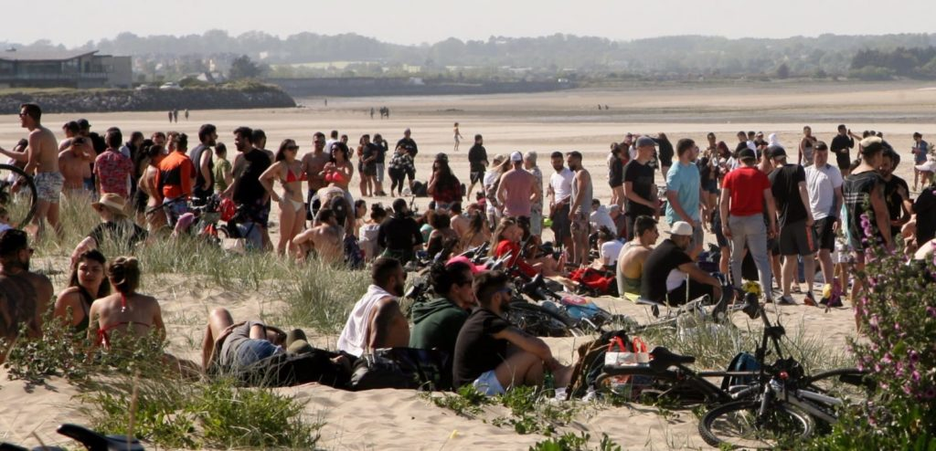 Public Call For Shutdown Of Beaches As Large Crowds Congregate