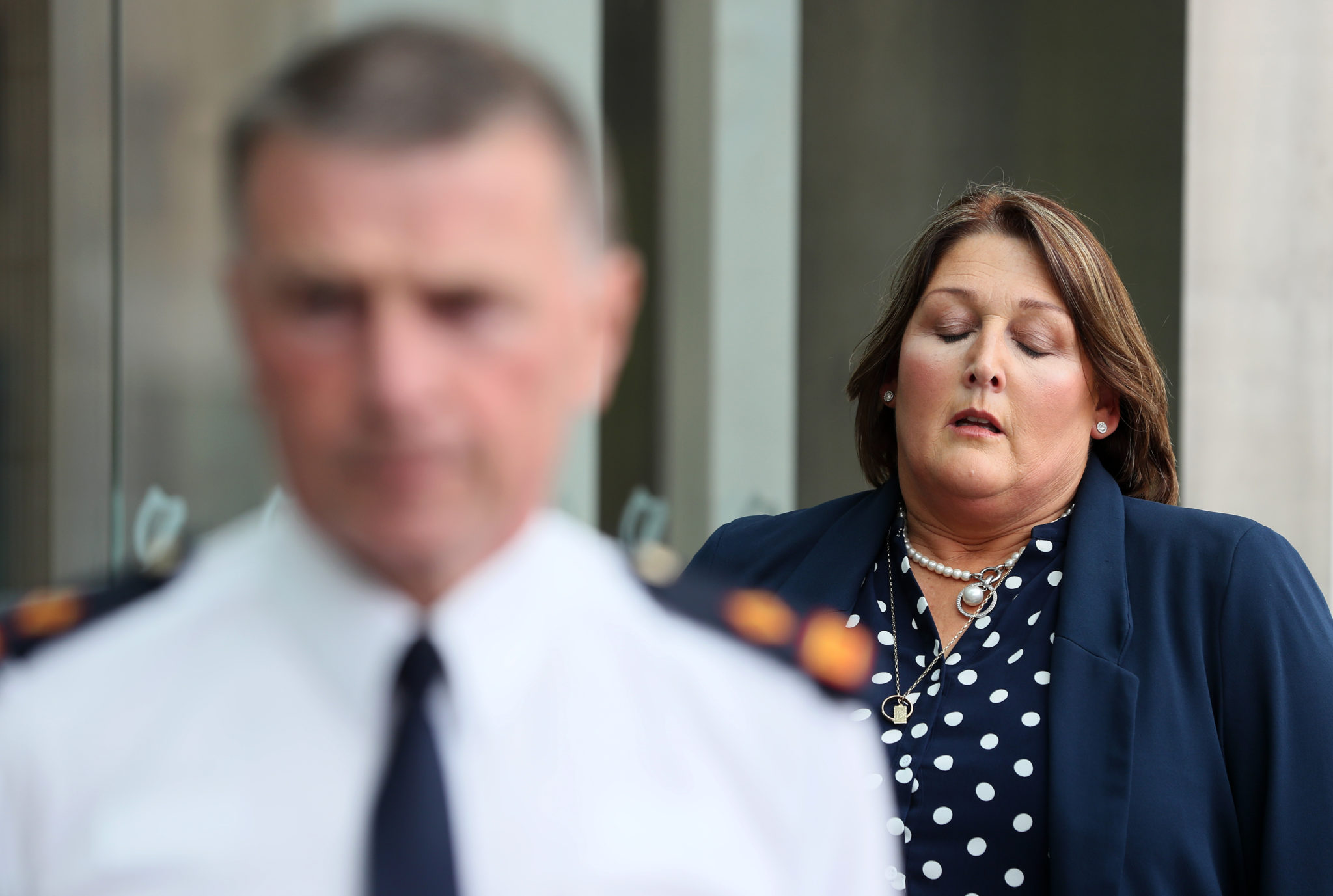 Adrian Donohoe's widow Caroline Donohoe prepares to speak outside the Criminal Courts of Justice
