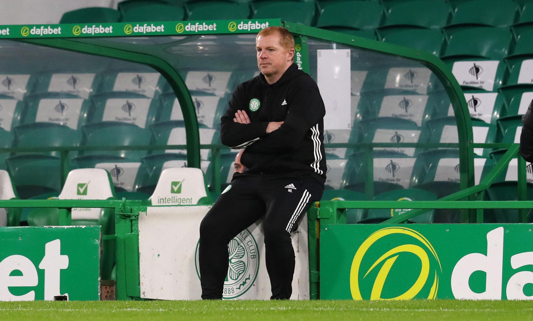 Neil Lennon sitting forlornly at Celtic Park
