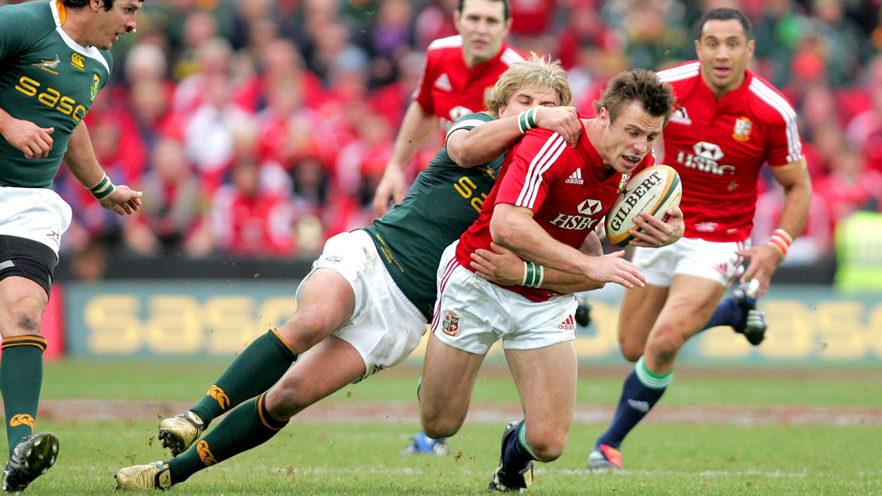 Tommy Bowe, British and Irish Lions, tries to escape a Wynand Olivier, South Africa, tackle. 3rd Test, South Africa v British and Irish Lions, Ellis Park, Johannesburg, South Africa.