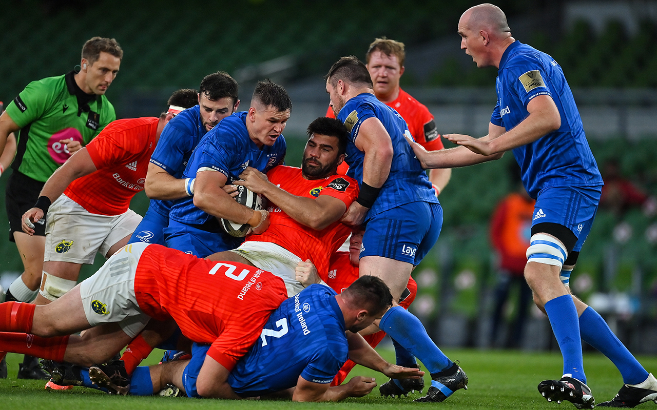 Jonathan Sexton of Leinster wins a turnover from Damian de Allende of Munster during the Guinness PRO14 Semi-Final