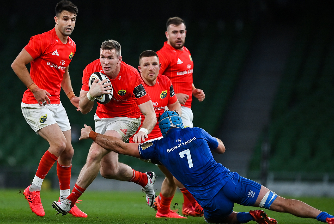 Chris Farrell of Munster is tackled by Will Connors of Leinster during the Guinness PRO14 Semi-Final match between Leinster and Munster at the Aviva Stadium in Dublin