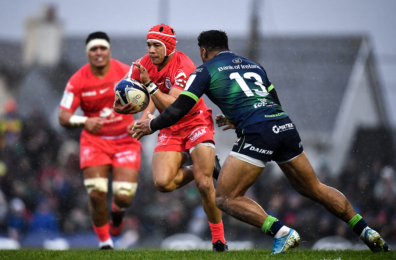 Cheslin Kolbe of Toulouse slips the tackle of Bundee Aki of Connacht during the Heineken Champions Cup Pool 5 Round 5 match between Connacht and Toulouse at The Sportsground in Galway