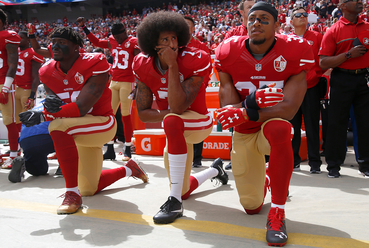From left, San Francisco 49ers' Eli Harold (58), quarterback Colin Kaepernick (7) and Eric Reid (35) kneel during the national anthem before their NFL game against the Dallas Cowboys on Sunday, October 2, 2016