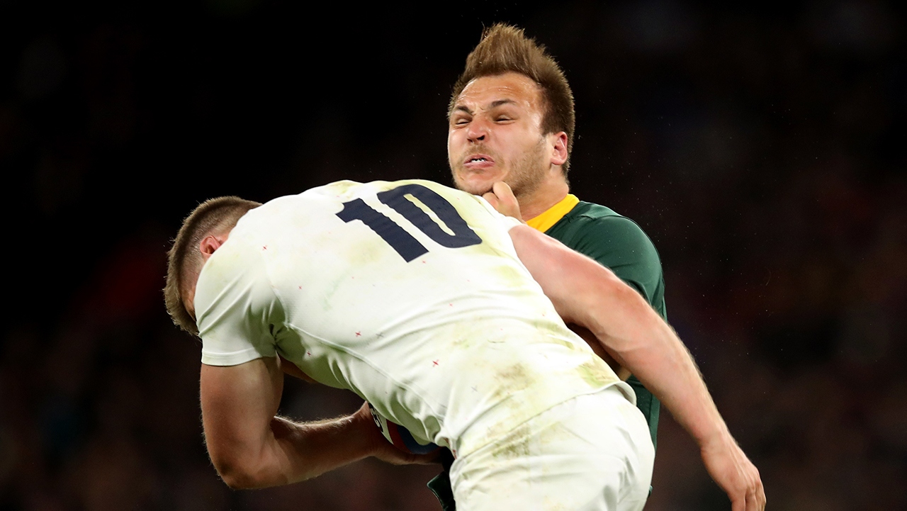 England's Owen Farrell tackles South Africa's Andre Esterhuizen during the Autumn International match at Twickenham Stadium, London.