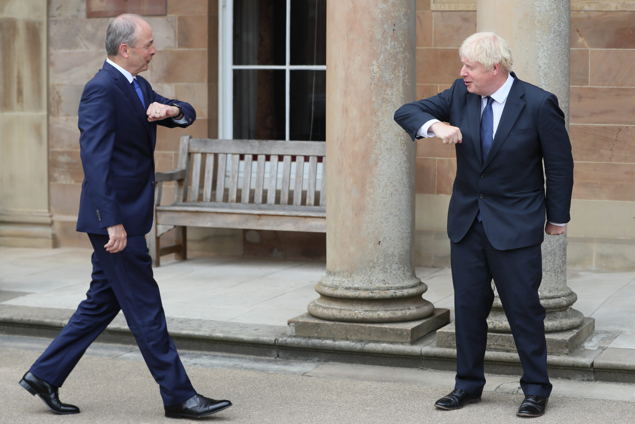 The Taoiseach Micheál Martin and UK Prime Minister Boris Johnson greet each other with an elbow bump at Hillsborough Castle in Belfast Brexit