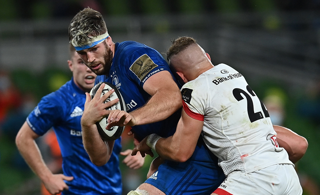 Caelan Doris of Leinster is tackled by Ian Madigan of Ulster during the Guinness PRO14 Final match between Leinster and Ulster at the Aviva Stadium in Dublin