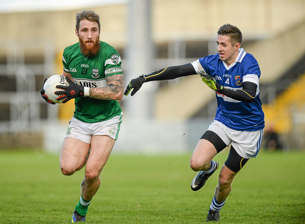 Zach Tuohy, Portlaoise, in action against Hugh Gill, St Vincent's. AIB Leinster GAA Football Senior Club Championship
