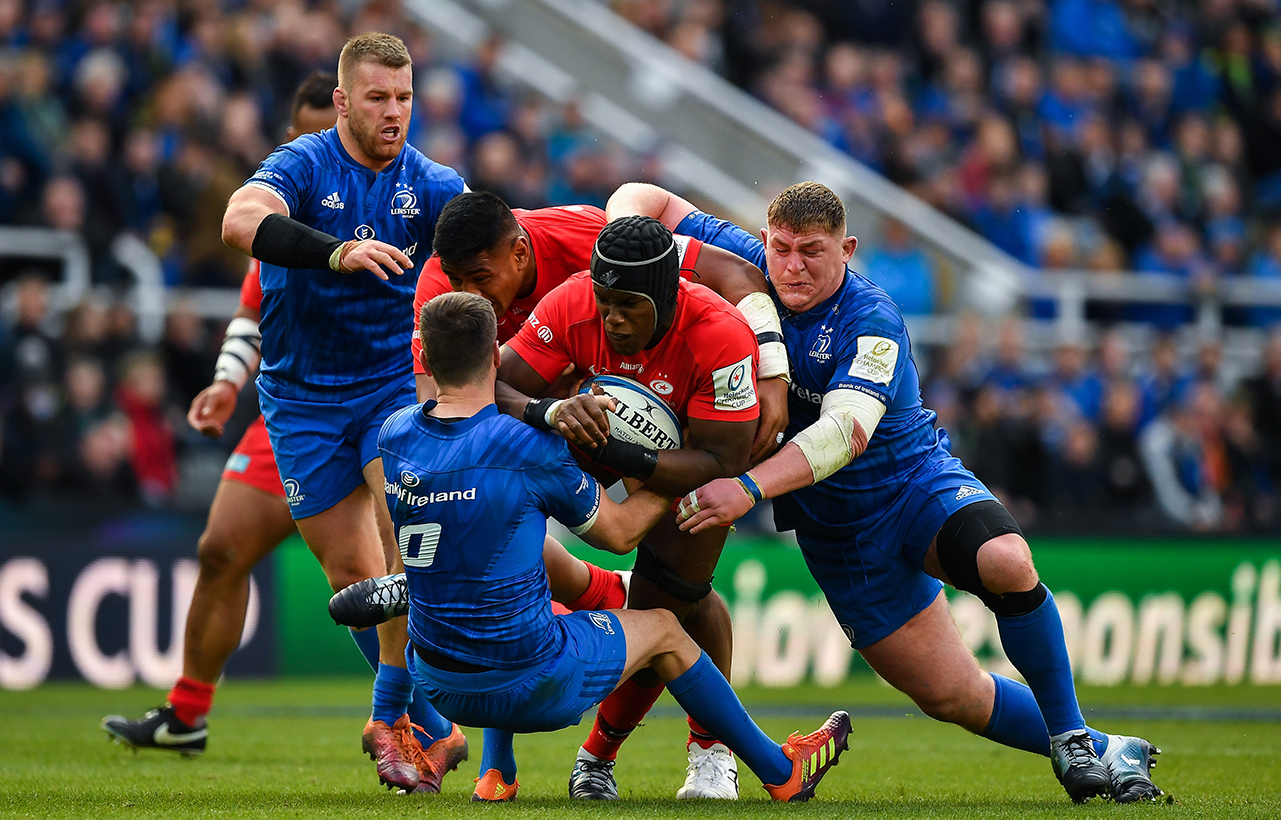 Maro Itoje of Saracens is tackled by Jonathan Sexton and Tadhg Furlong of Leinster during the Heineken Champions Cup Final match between Leinster and Saracens at St James' Park in Newcastle Upon Tyne