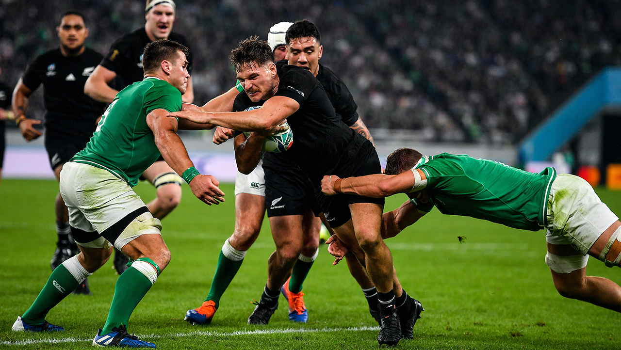 George Bridge of New Zealand is tackled by CJ Stander, left, and Josh Van der Flier of Ireland during the 2019 Rugby World Cup Quarter-Final match between New Zealand and Ireland at the Tokyo Stadium
