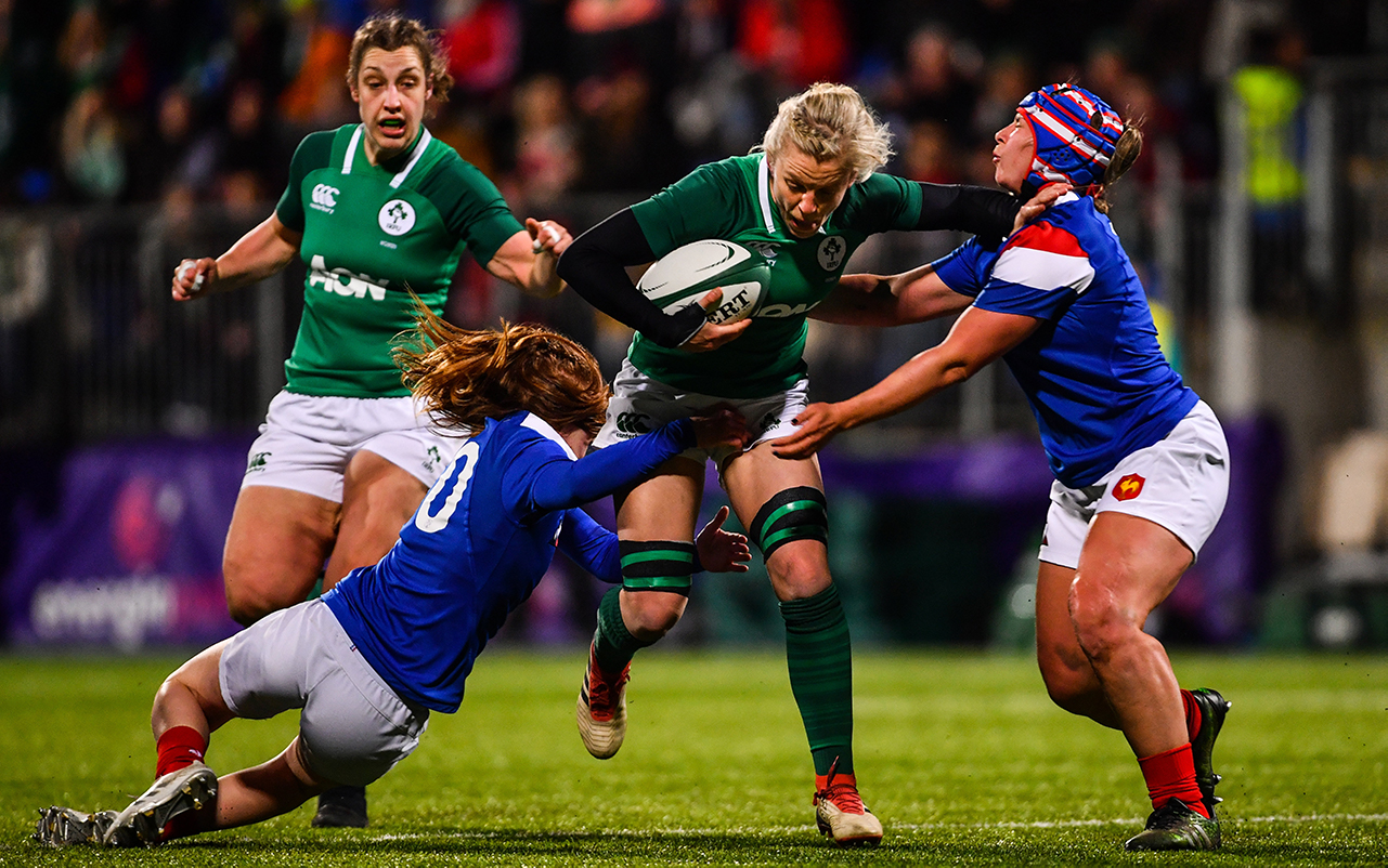 Claire Molloy of Ireland is tackled by Pauline Bourdon, left, and Caroline Thomas of France during the Women's Six Nations Rugby Championship match between Ireland and France at Energia Park in Donnybrook