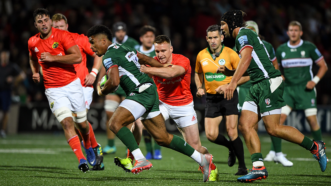 Ben Loader of London Irish is tackled by Rory Scannell of Munster during the Pre-season friendly match between Munster and London Irish at the Irish Independent Park in Cor