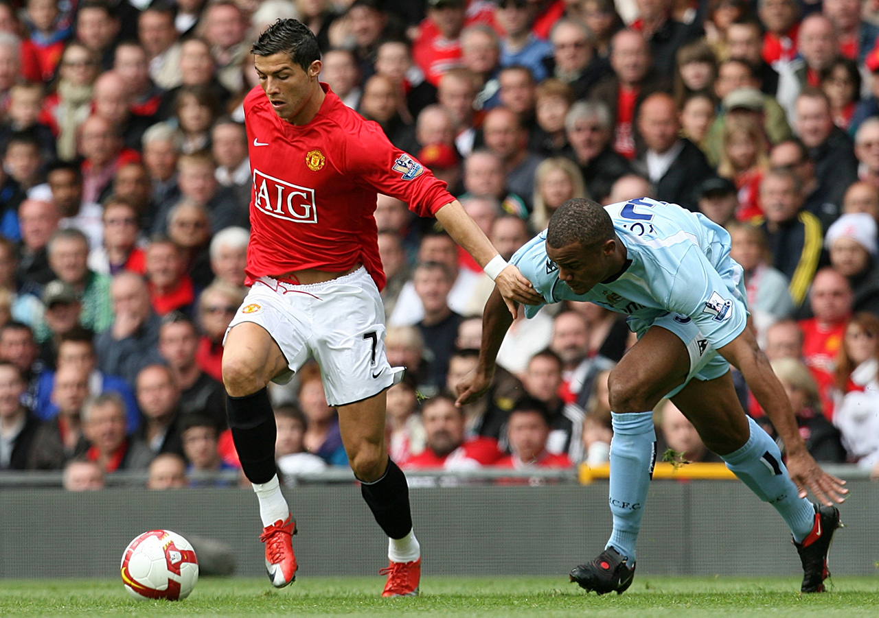 Manchester United's Cristiano Ronaldo (left) and Manchester City's Vincent Kompany (right) battle for the ball.