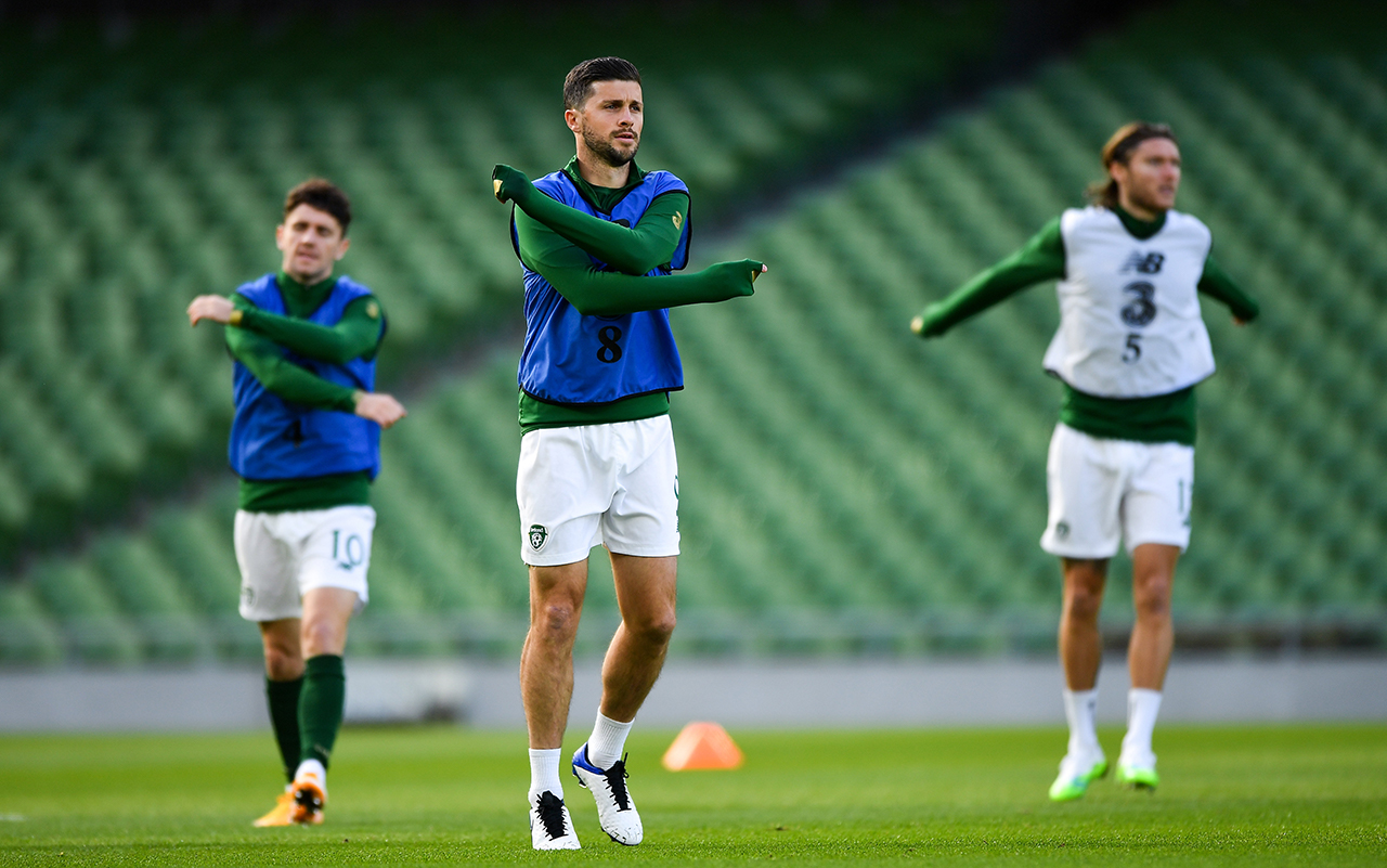 Shane Long of Republic of Ireland, centre, warms-up alongside team-mates Robbie Brady, left, and Jeff Hendrick prior to the UEFA Nations League B match between Republic of Ireland and Wales at the Aviva Stadium in Dublin