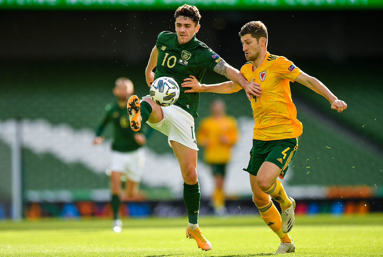 Robbie Brady of Republic of Ireland in action against Ben Davies of Wales during the UEFA Nations League B match between Republic of Ireland and Wales at the Aviva Stadium in Dublin