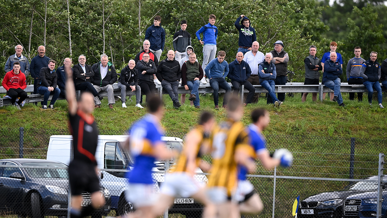 Supporters watch on from outside the ground during the Armagh County Senior Football League Group A Round 1 match between Maghery Sean McDermotts and Crossmaglen Rangers at Felix Hamill Park in Maghery, Armagh
