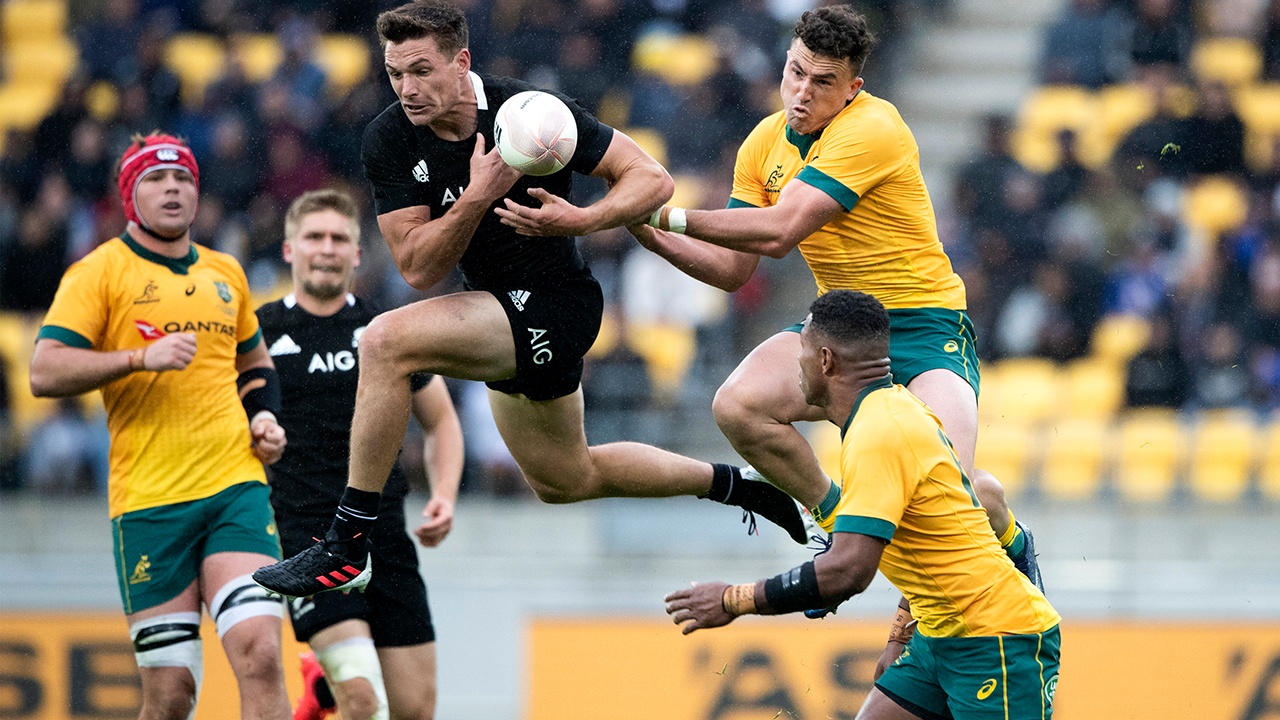 New Zealand's George Bridge, centre, and Australia's Tom Banks, top right, leap for the ball during the Bledisloe Cup rugby game between the All Blacks and the Wallabies in Wellington, New Zealand, Sunday, Oct.11, 2020. The game ended in a 16 all draw