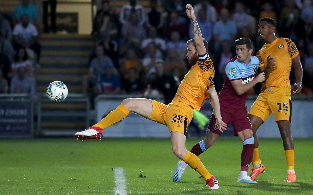Newport County's Mark O'Brien nearly scores during the Carabao Cup Second Round match at Rodney Parade, Newport.