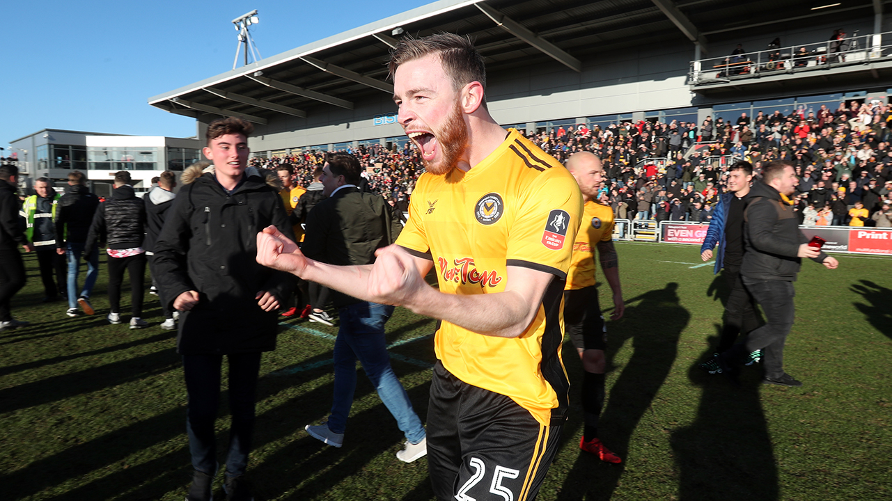Newport County's Mark O'Brien celebrates victory after the Emirates FA Cup, Third Round match at Rodney Parade, Newport.