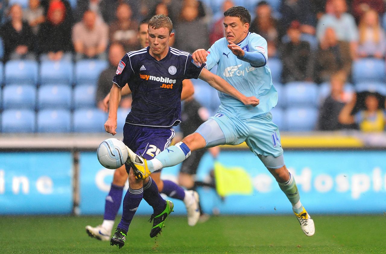 Coventry City's Cody McDonald and Derby County's Mark O'Brien (left) battle for the ball during the npower Football League Championship match at the Ricoh Arena, Coventry.