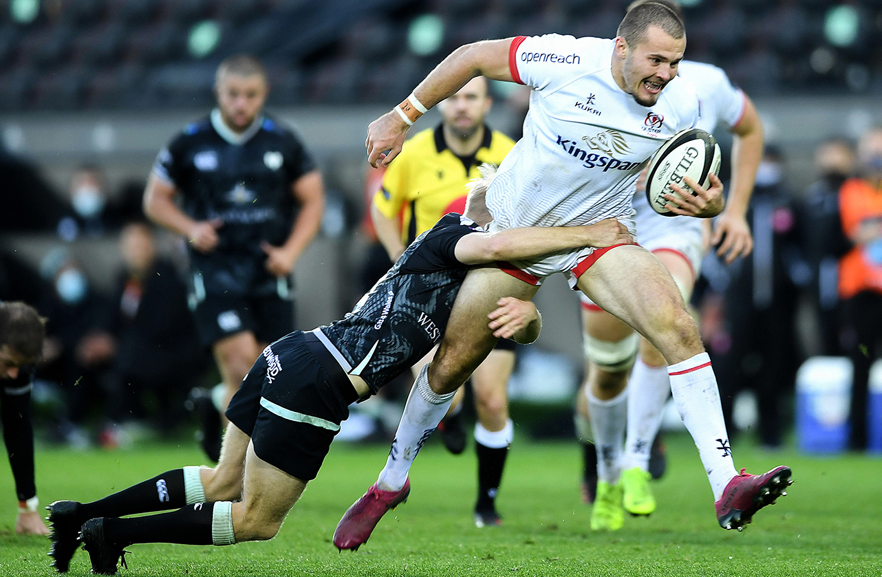Jacob Stockdale of Ulster is tackled by Mat Protheroe of Ospreys during the Guinness PRO14 match between Ospreys and Ulster at Liberty Stadium in Swansea, Wales.