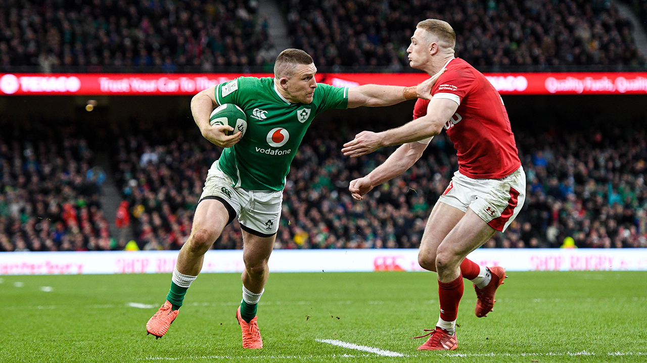 Andrew Conway of Ireland on his way to scoring his side's fourth try despite the tackle of Johnny McNicholl of Wales during the Guinness Six Nations Rugby Championship match between Ireland and Wales at the Aviva Stadium in Dublin.