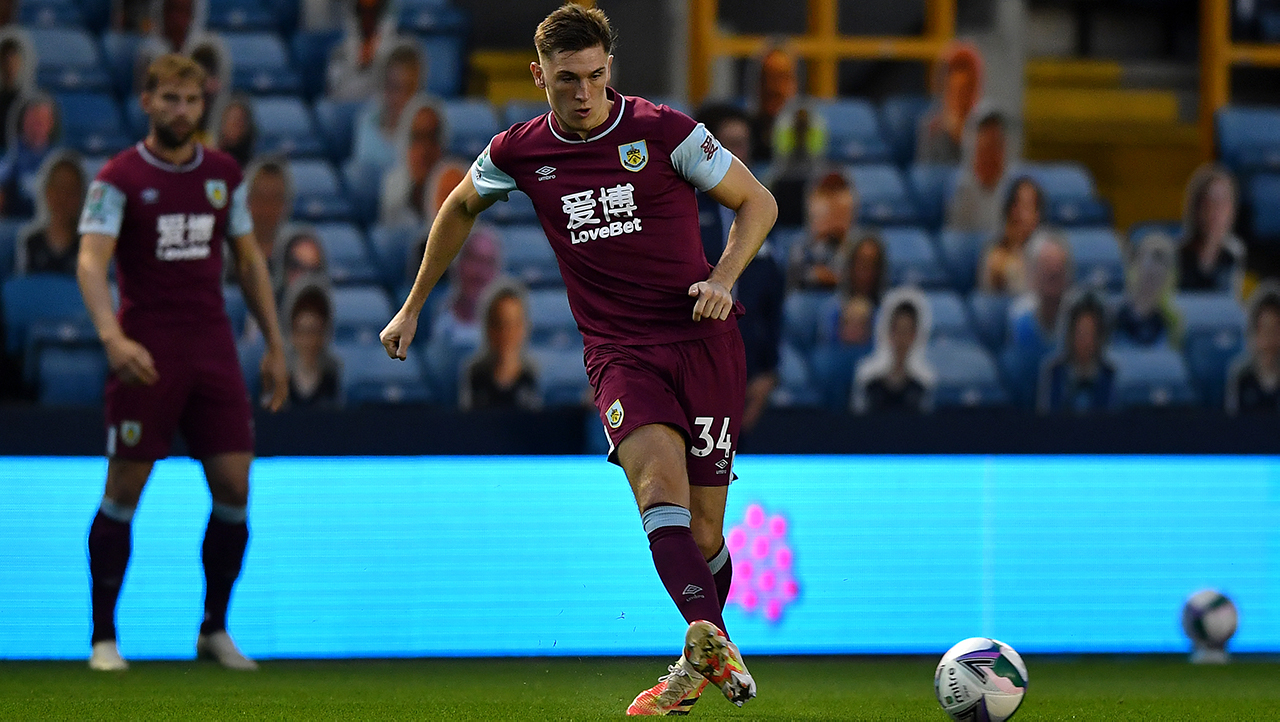 Burnley's Jimmy Dunne warming up before the Carabao Cup third round match at The New Den, London.