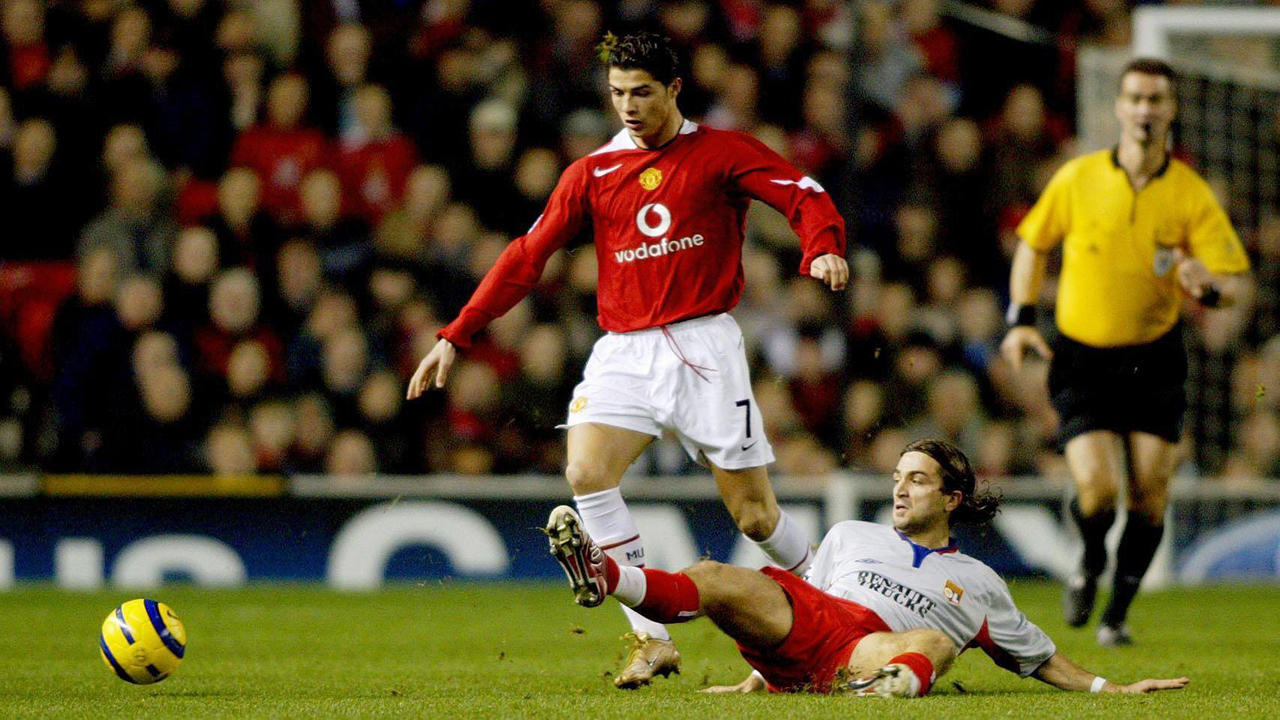 Jeremy Berthod of Olympique Lyonnais can't prevent Manchester United's Cristiano Ronaldo from dribbling past him, in the European Champions League Group D match at Old Trafford, Manchester.