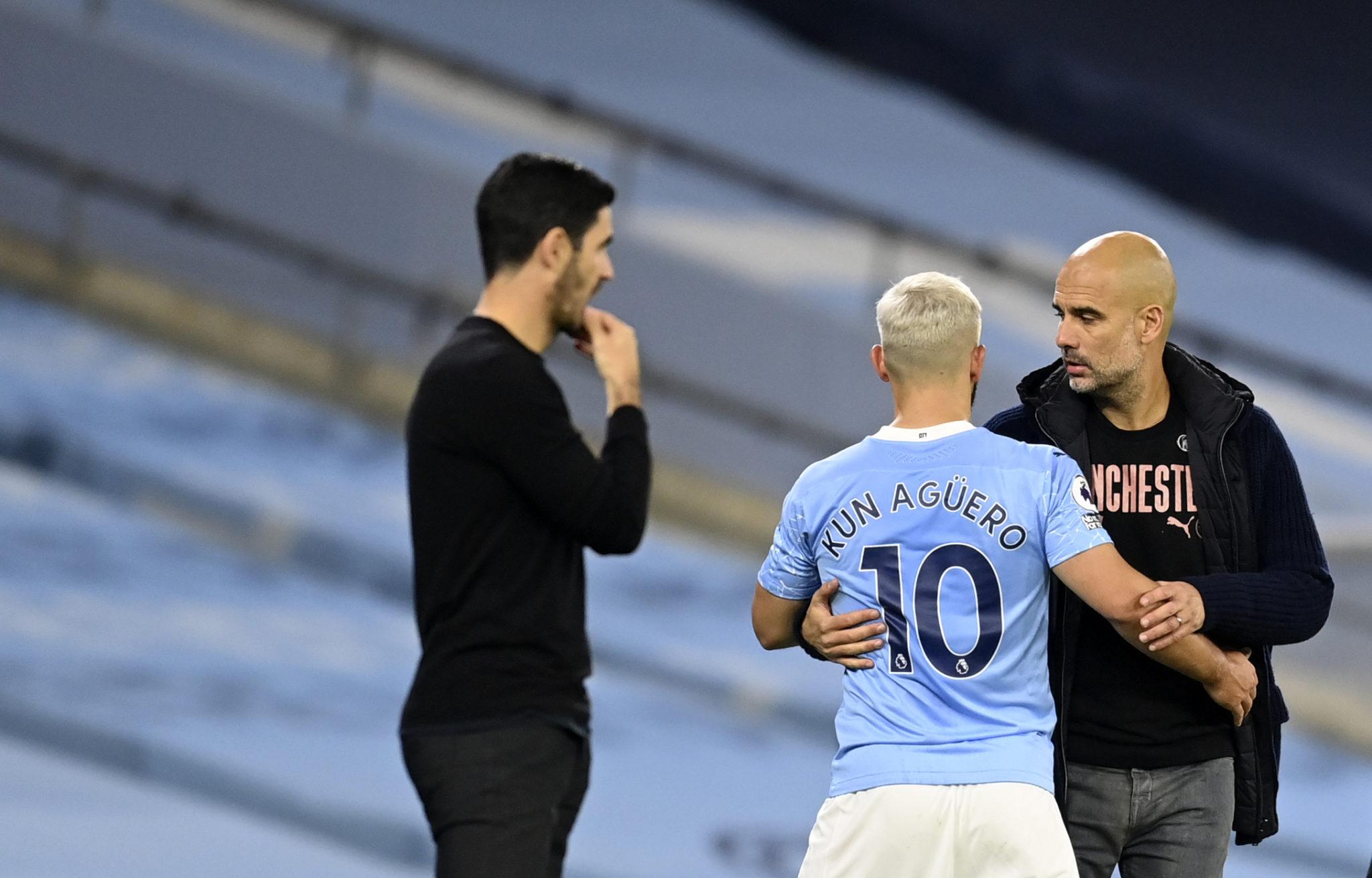 Pep Guardiola and Sergio Aguero of Manchester City.