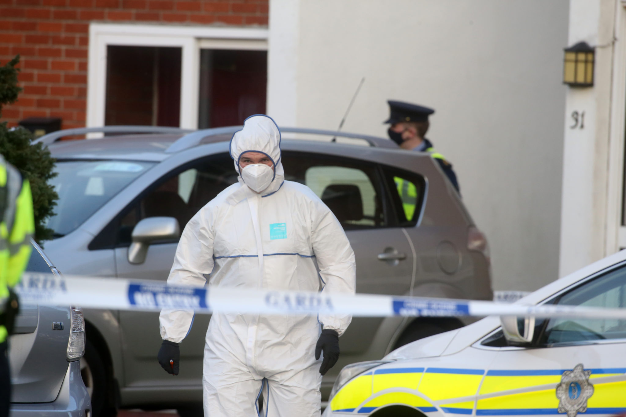 Gardaí in the Llewellyn estate in Ballinteer after the bodies of a woman and two children were discovered dead in Dublin