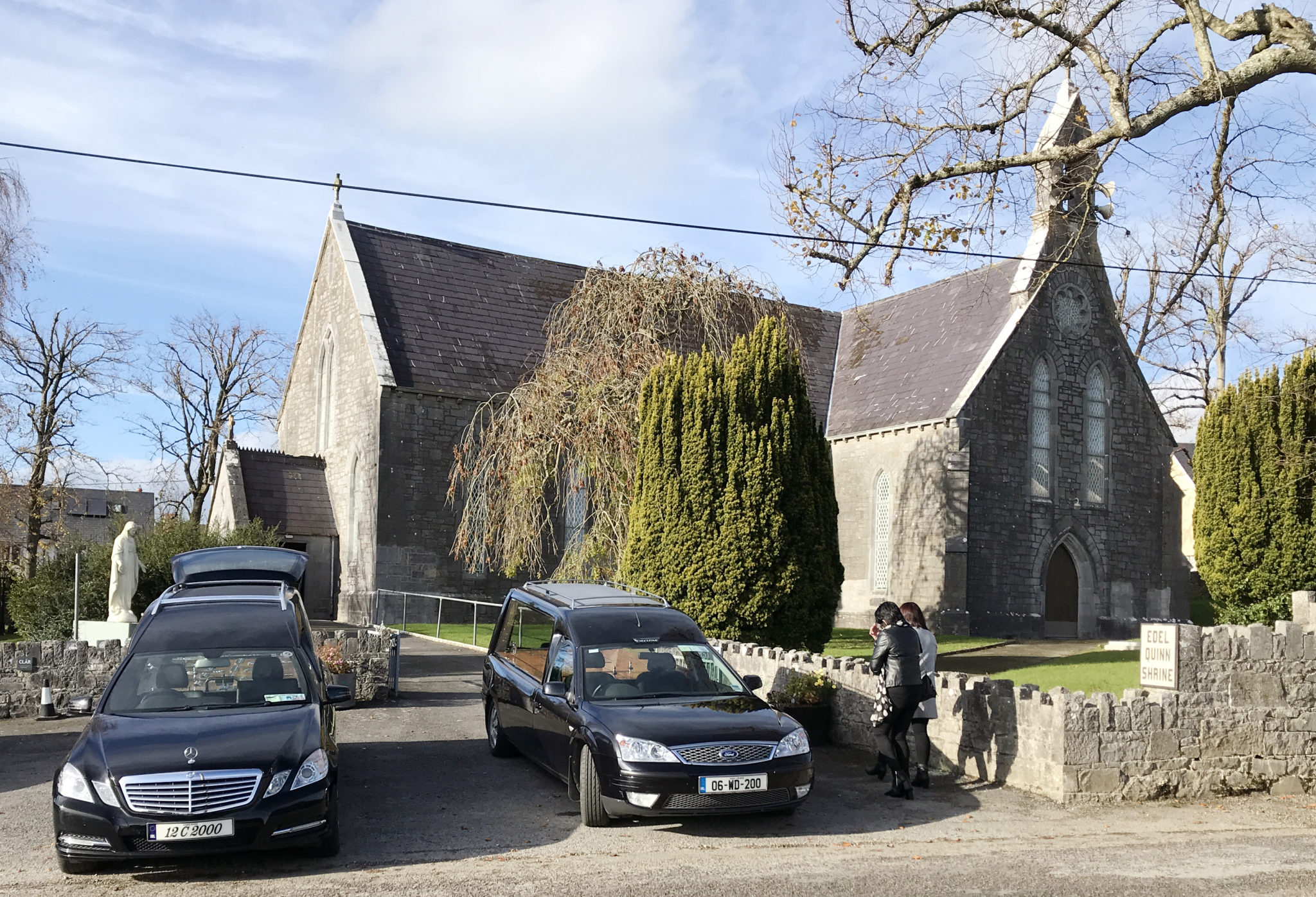 Hearses parked outside St Mary's Church, Castlemagner, County Cork before the funeral of Diarmuid O'Sullivan and Tadhg O'Sullivan Kanturk