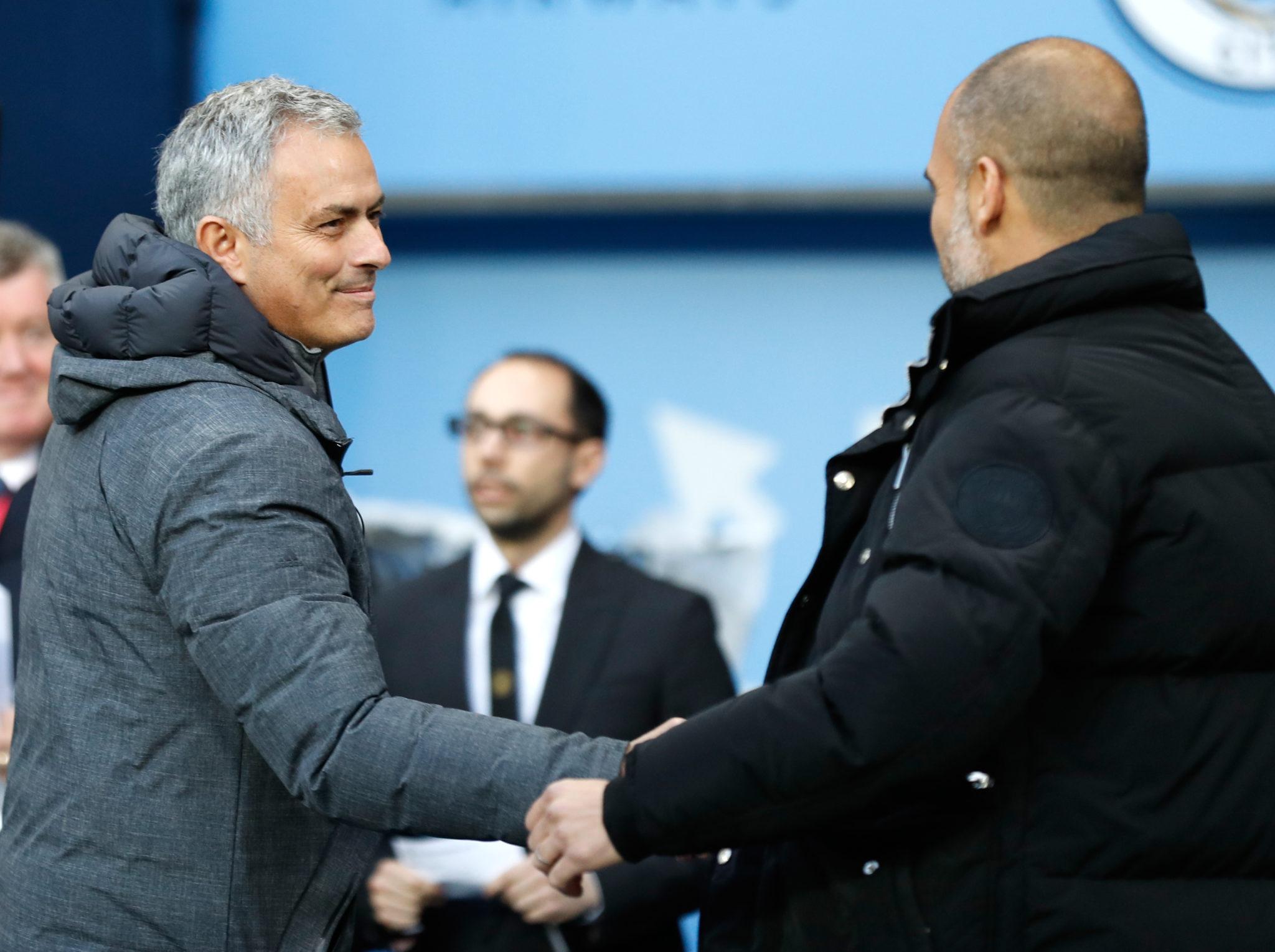 Pep Guardiola and Jose Mourinho shake hands