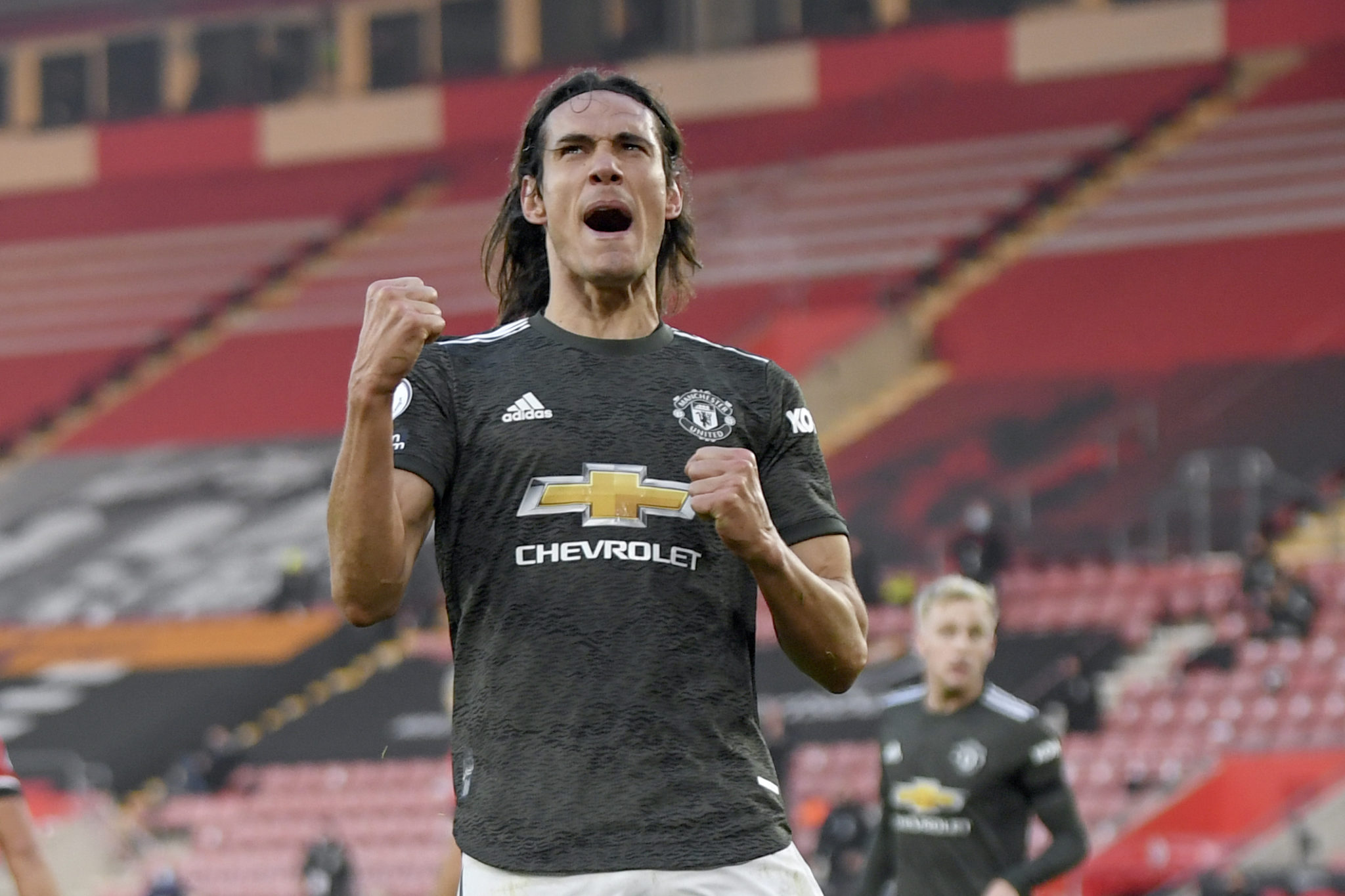 Cavani celebrates a goal at Old Trafford.