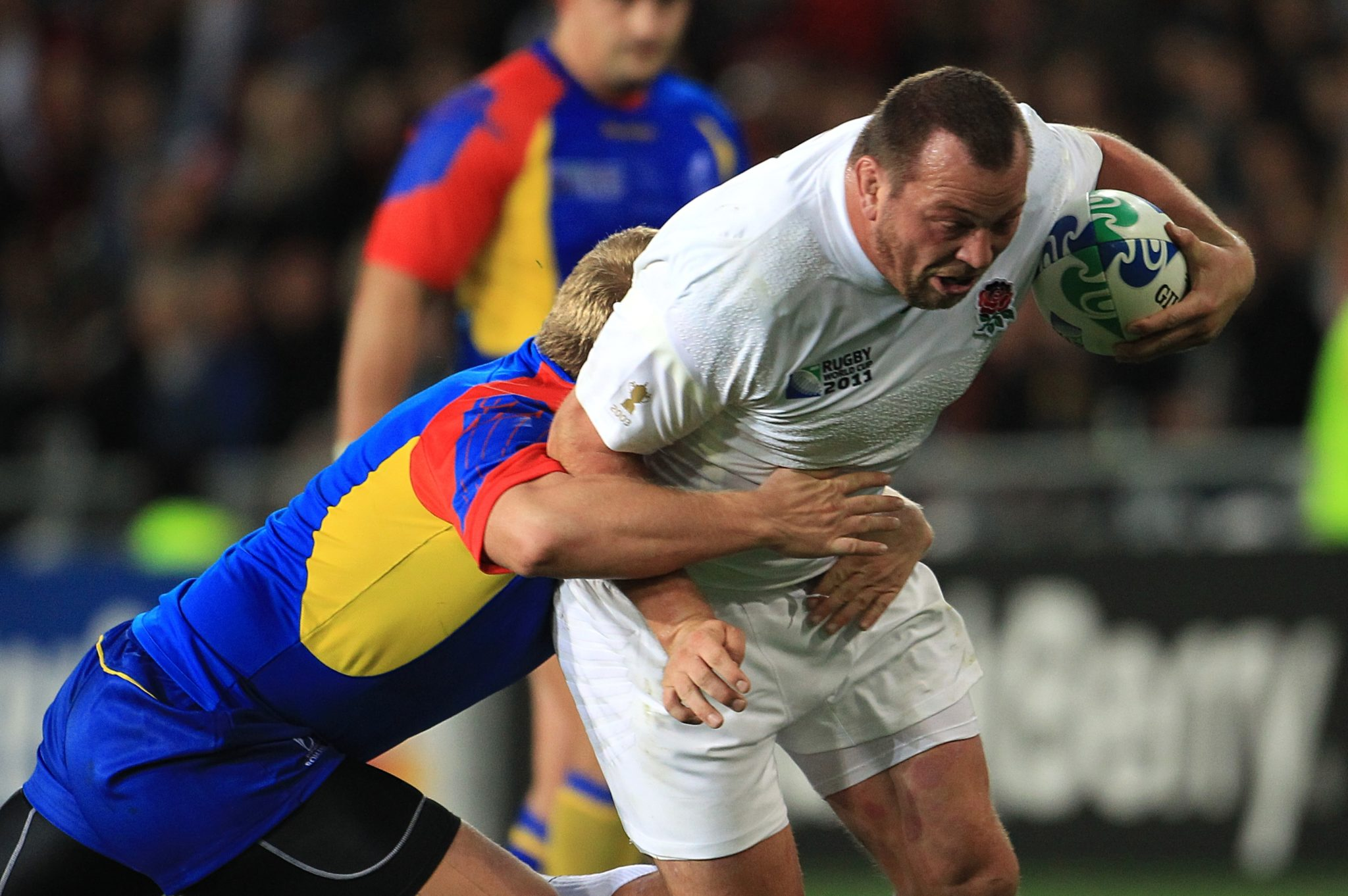 England rugby player Steve Thompson evades a tackle