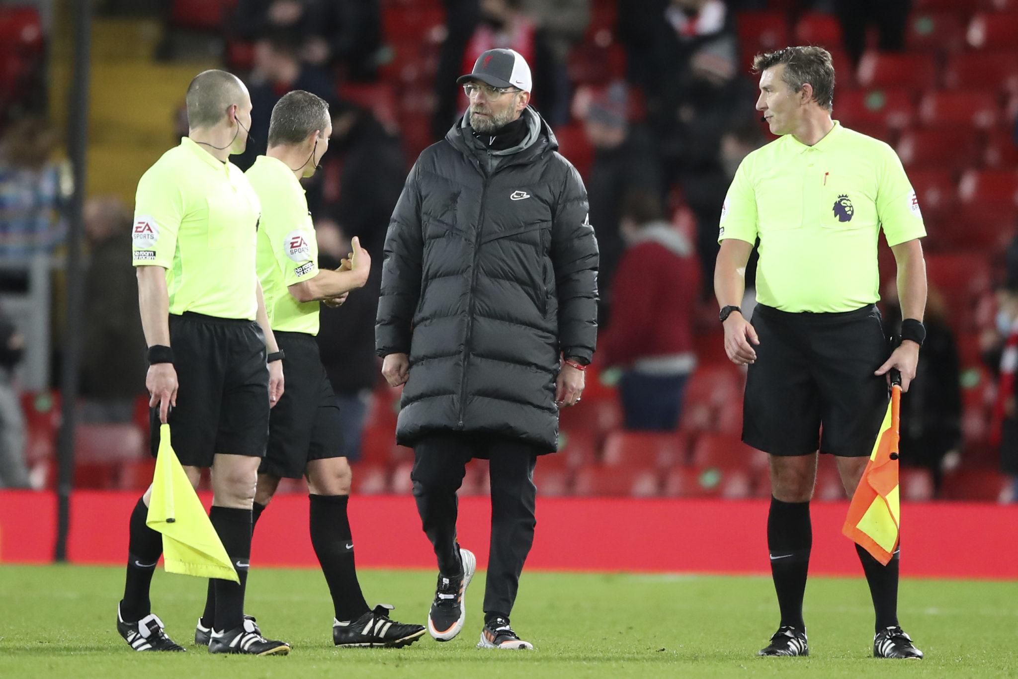 Liverpool manager Jurgen Klopp talks with match officials