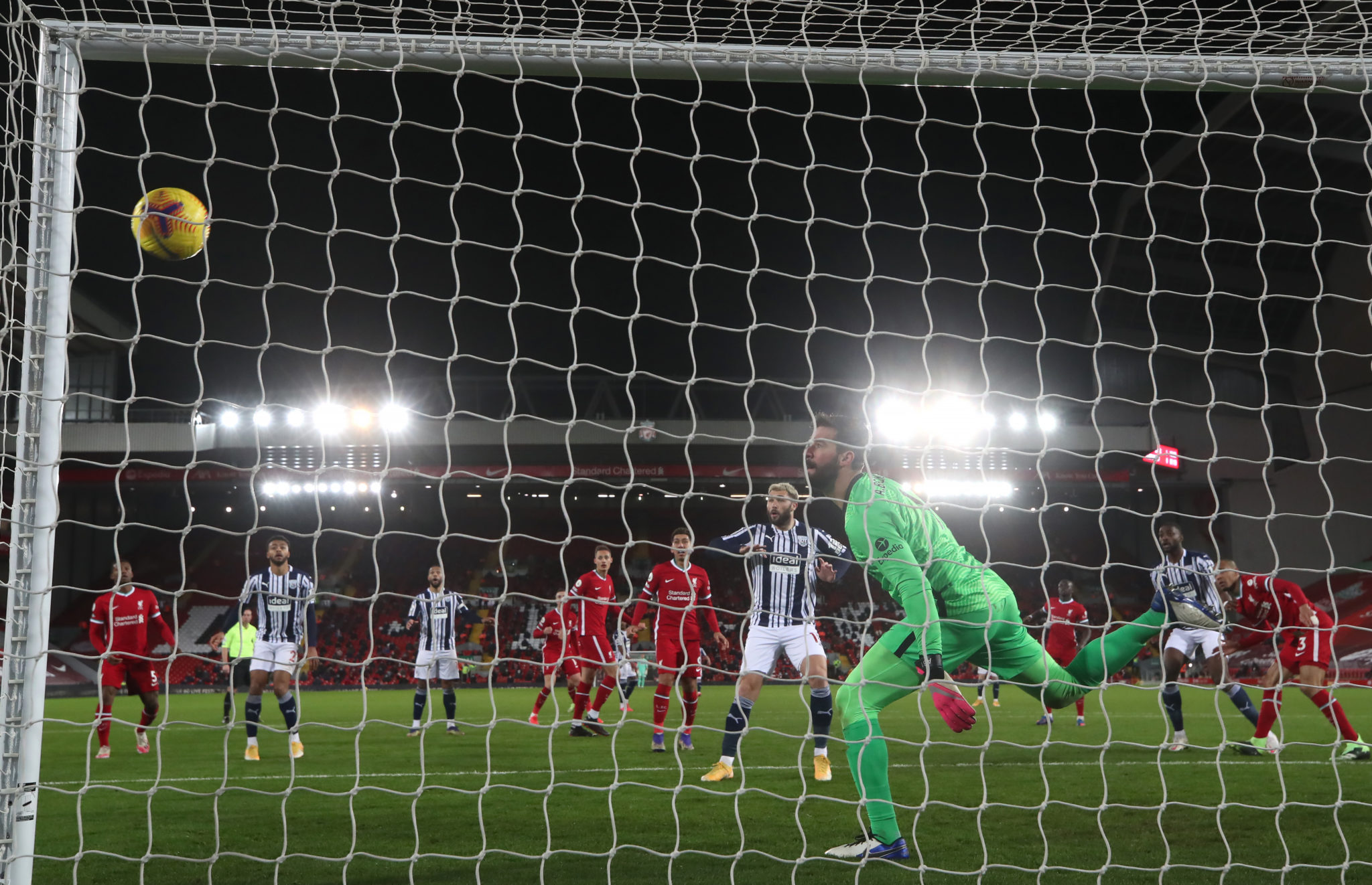 Semi Ajayi beats Alisson Becker in the Liverpool goal with a header.