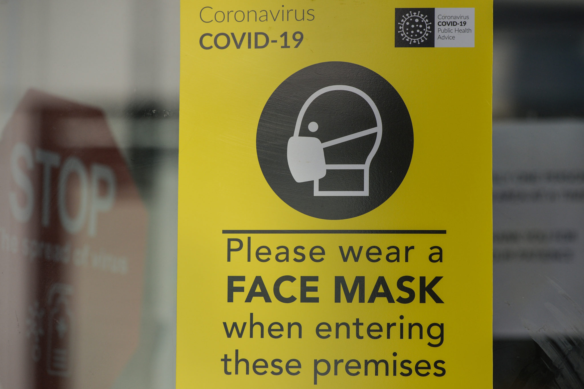 A sign asking people to wear a mask