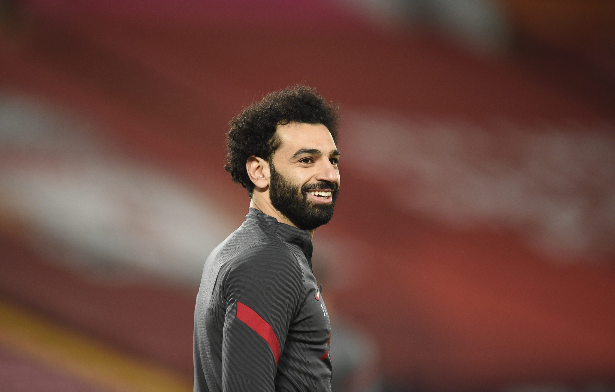 Mohamed Salah warms up for Liverpool