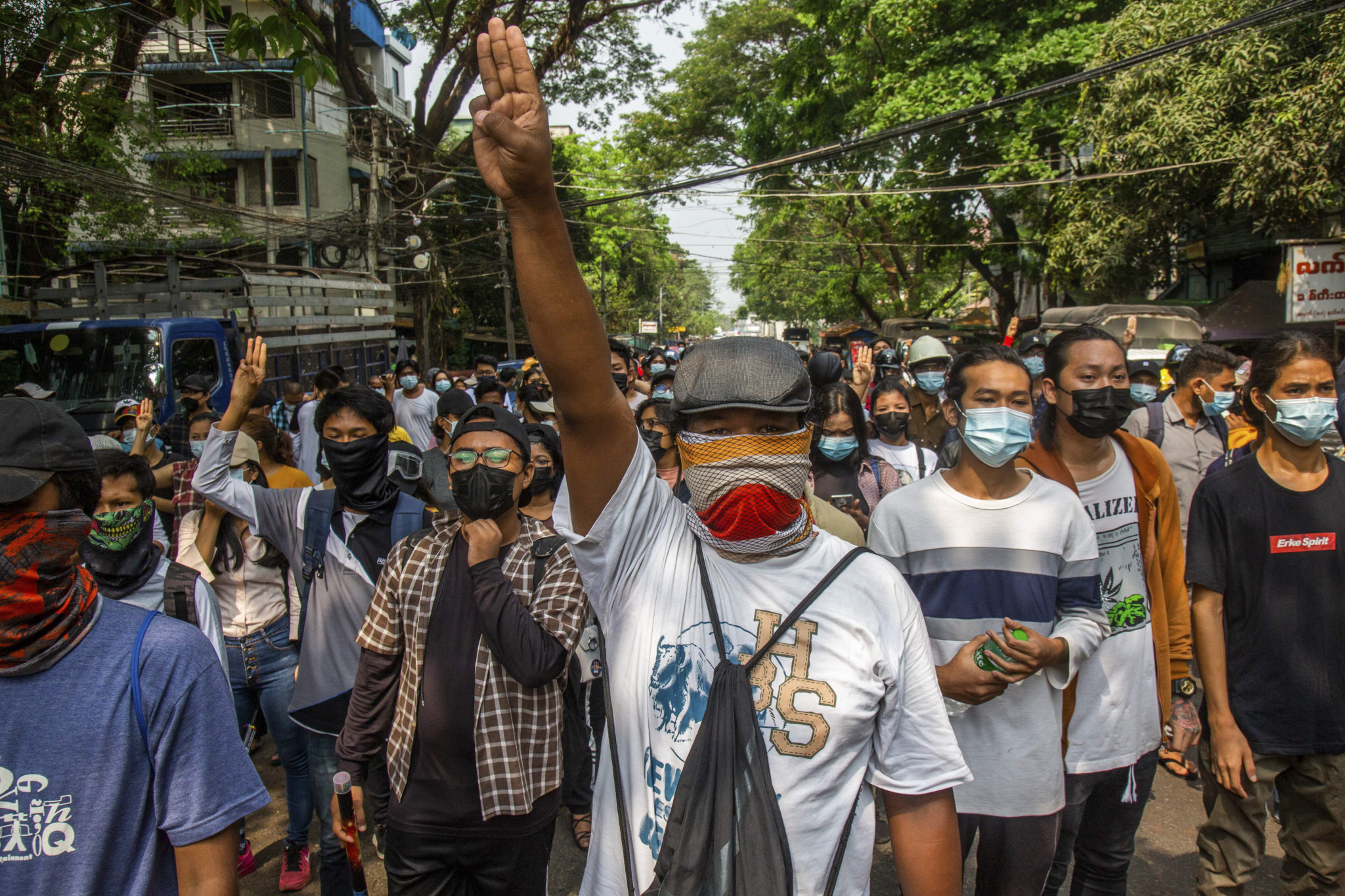 Anti-coup protesters gesture with a three-fingers salute a symbol of resistance during a demonstration in Yangon Myanmar yesterday. Credit AP
