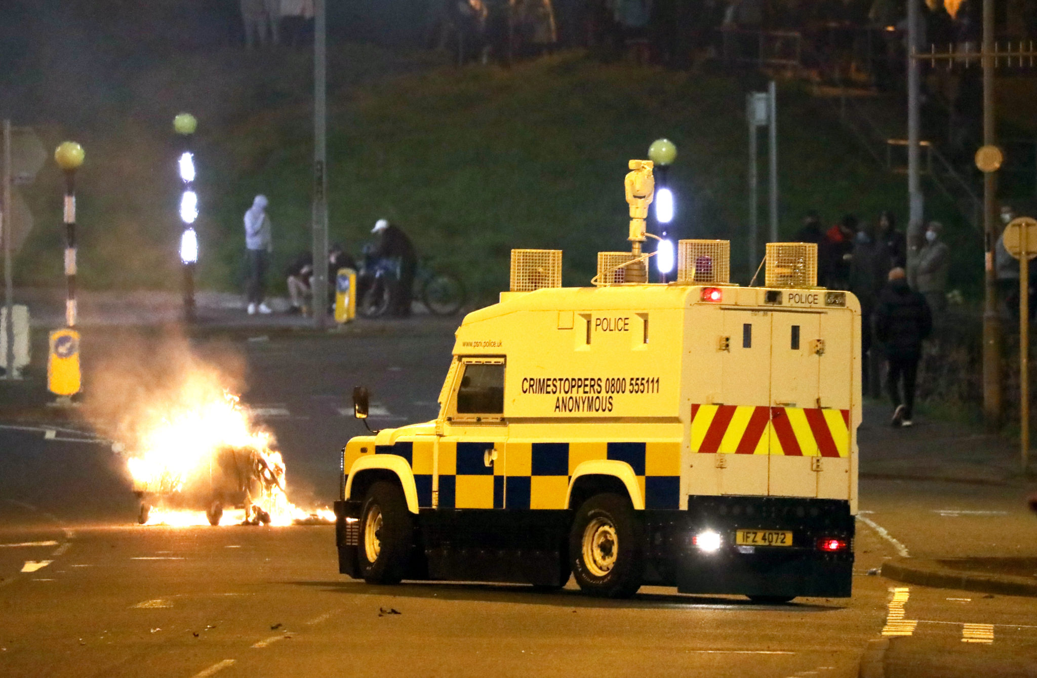 Newtownabbey: Petrol bombs and bricks launched at PSNI