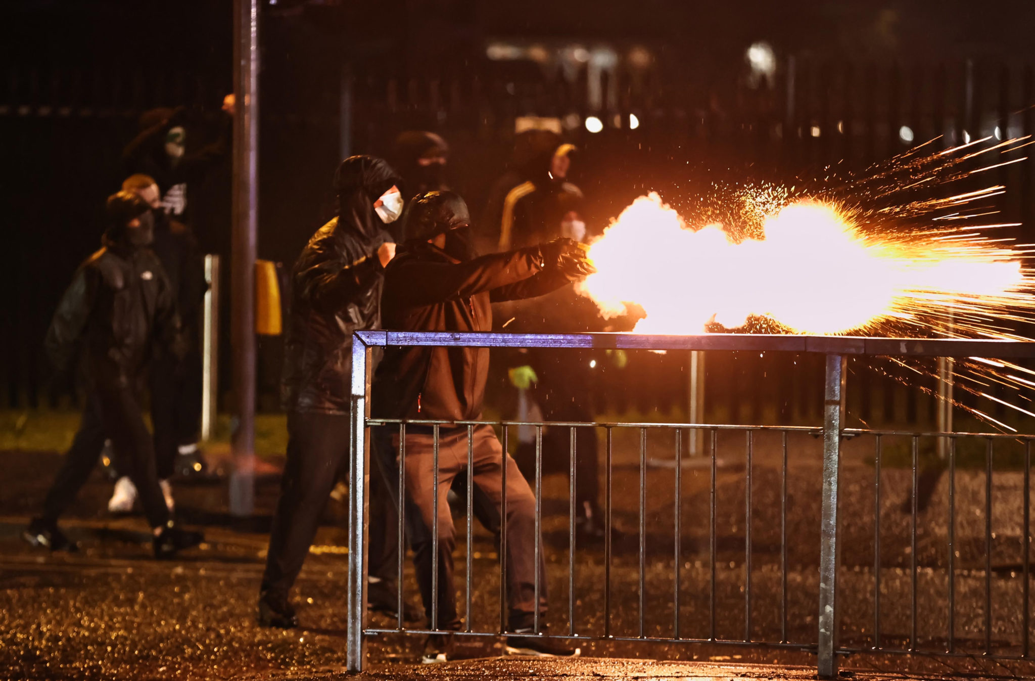Youths fire fireworks at the PSNI on the Springfield road, during further unrest in Belfast