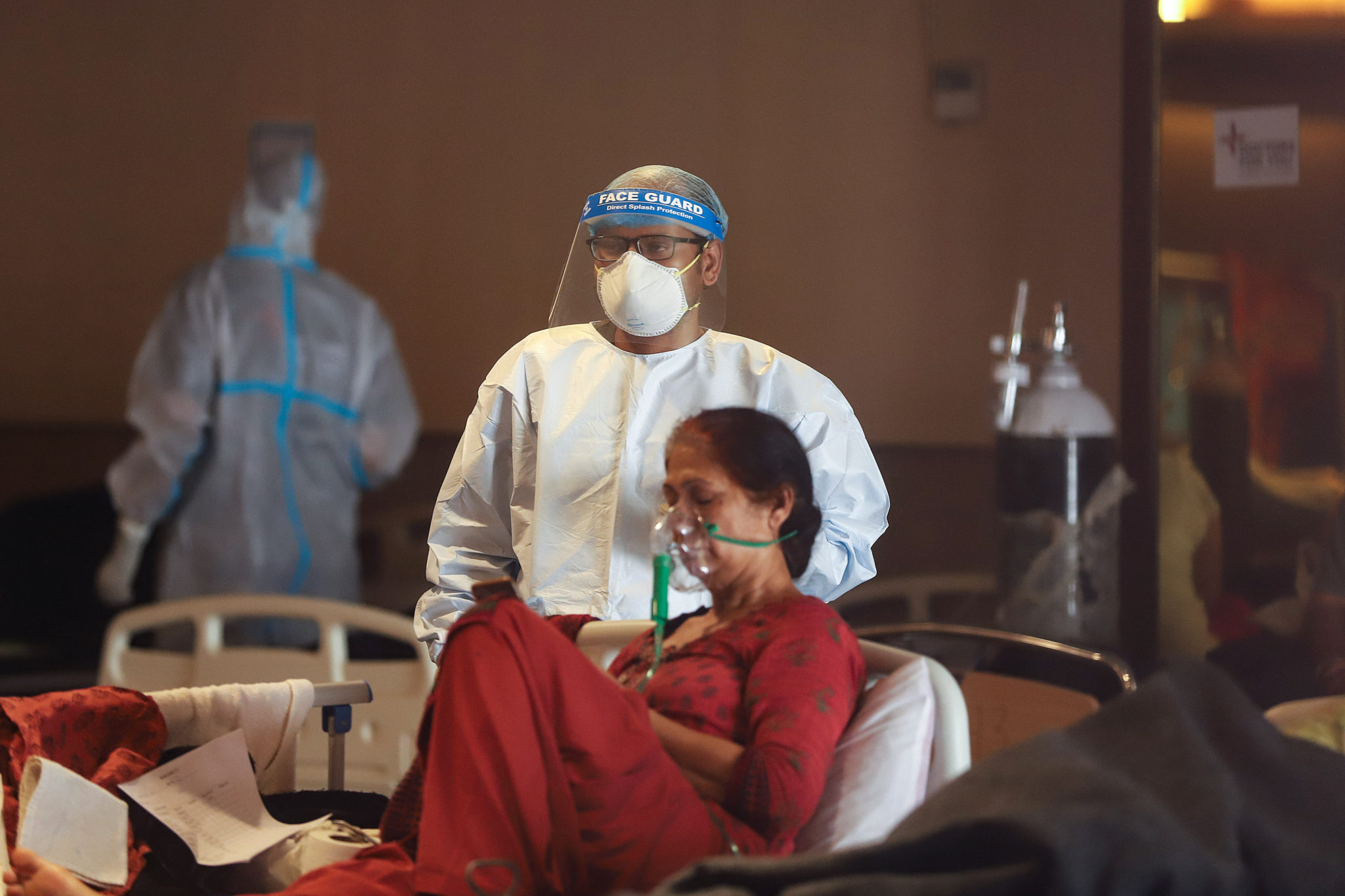 A Covid-19 patient seen resting in a Covid-19 isolation ward in New Delhi, India.